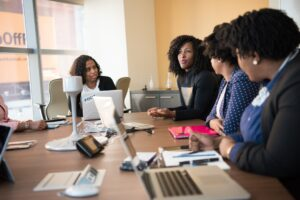 Women having a meeting with laptops around a table