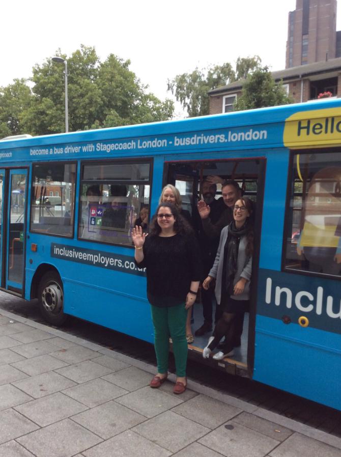 Team members getting on the NIW bus