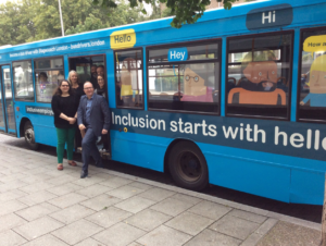 Team members with the inclusion bus