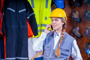 Female construction worker chatting on phone