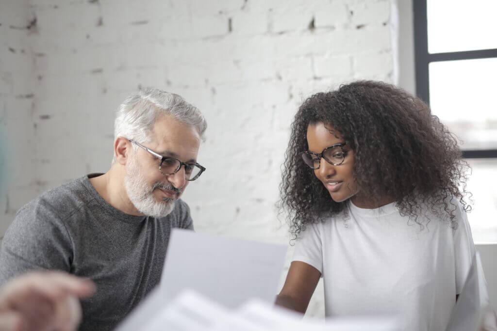 A white man and a black woman having a conversation