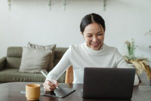 Woman smiling learning via a laptop