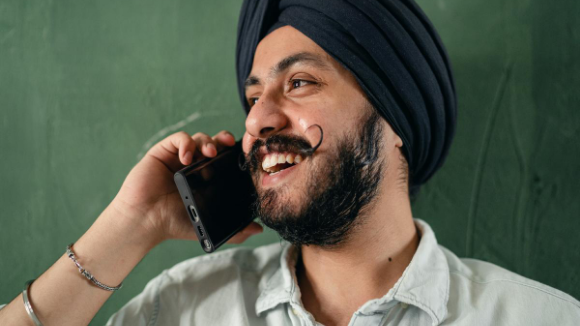 Sikh Man having a phone call and smiling