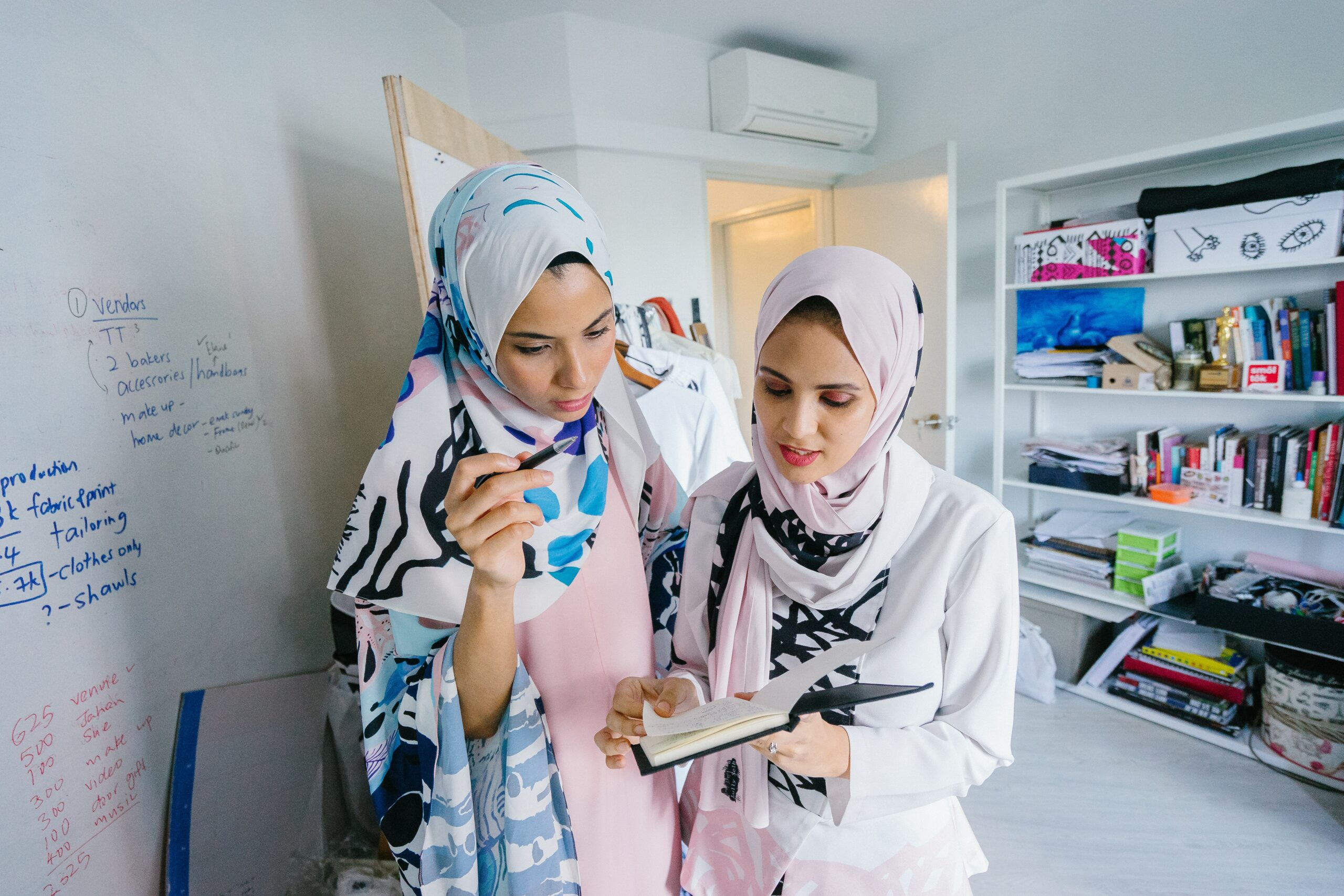 Female Muslim scientists working together on a project