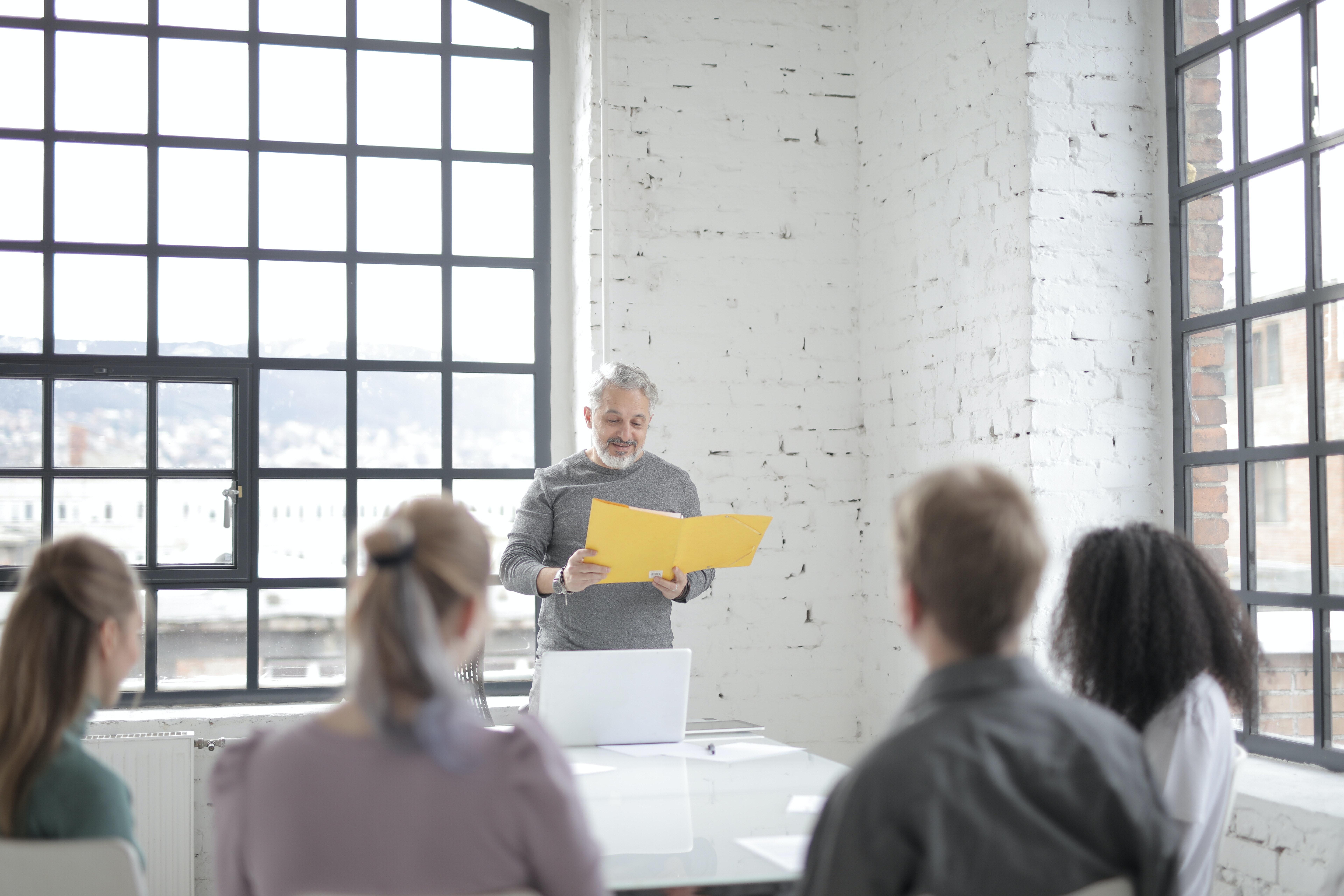 Man giving a talk on International Men's Day