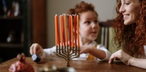 Mother and child celebrating Hannukah