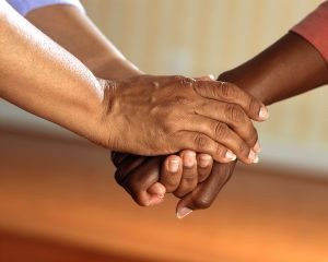 2 people holding hands