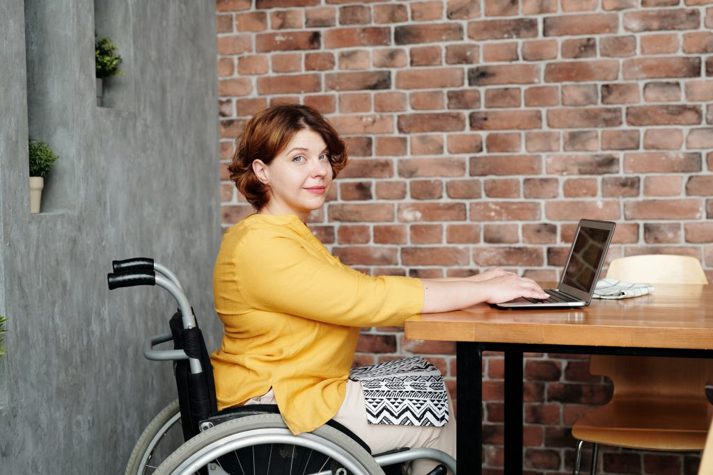 Wheelchair user working from home