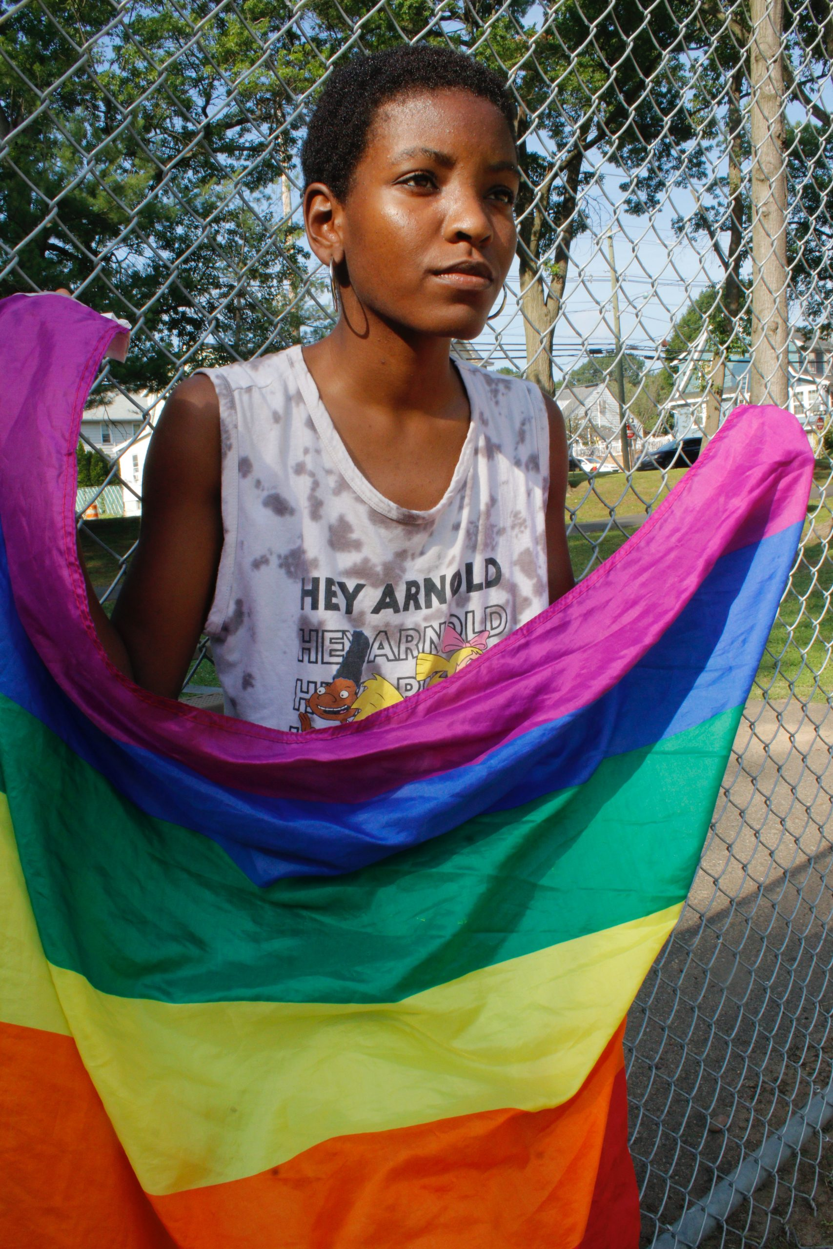 Person holding LGBT Pride flag