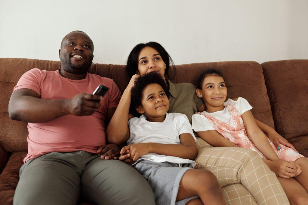 Family enjoying television