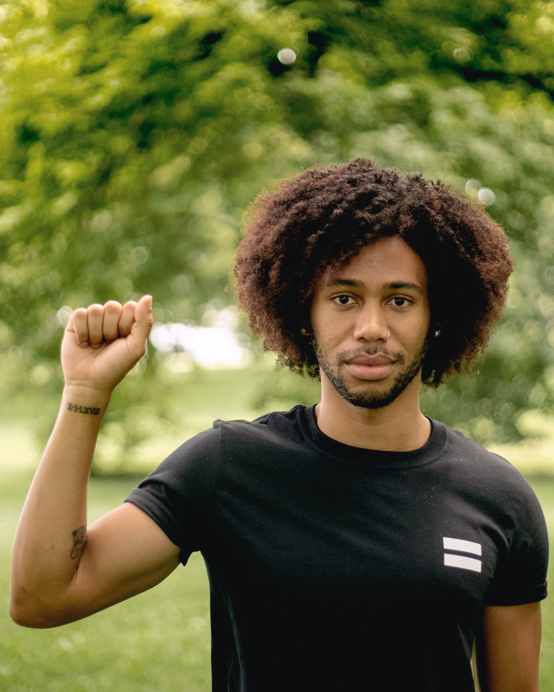 A black man raising his fist in solidarity with black lives matter