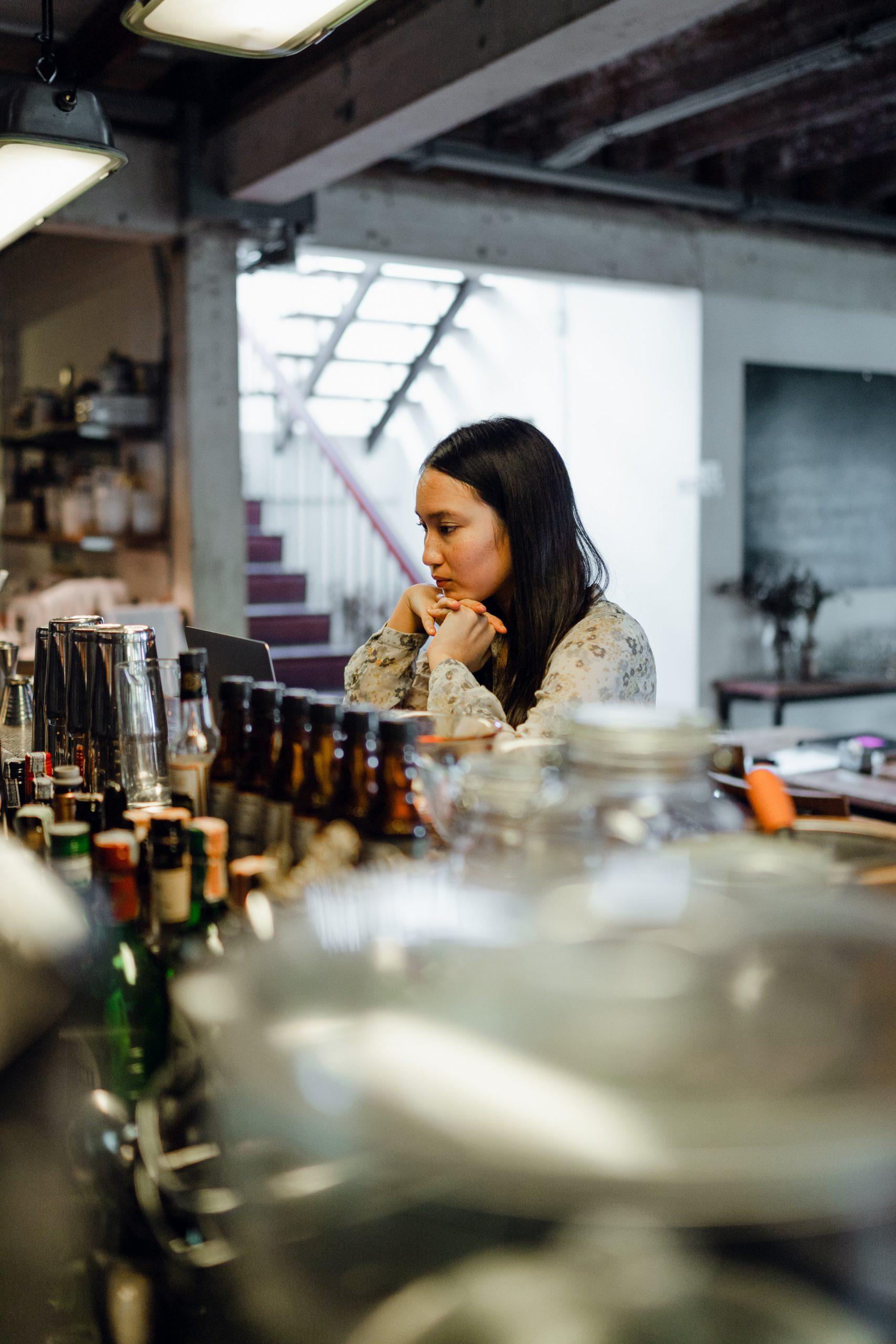lonely woman sitting inside empty pub