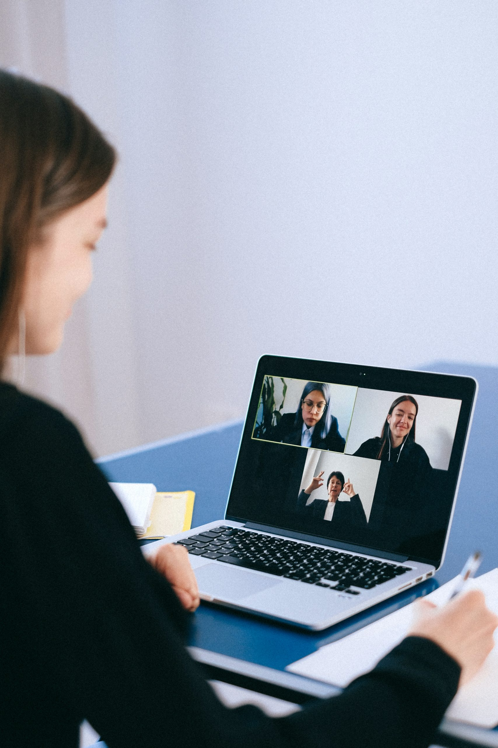 Person on a zoom call with people in their staff network