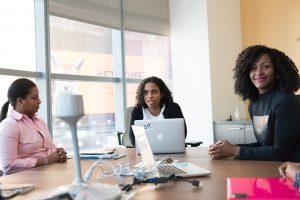 Three women have an international women's day meeting