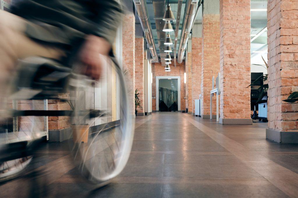 Shot of wheelchair user rolling down hallway