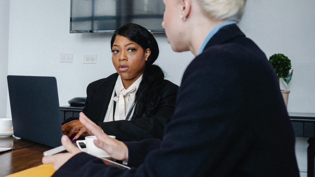 Black woman experiencing a microagression from a colleague