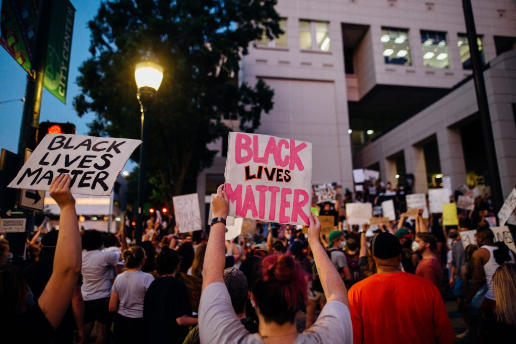 Black Lives Matter placards being held up at a protest