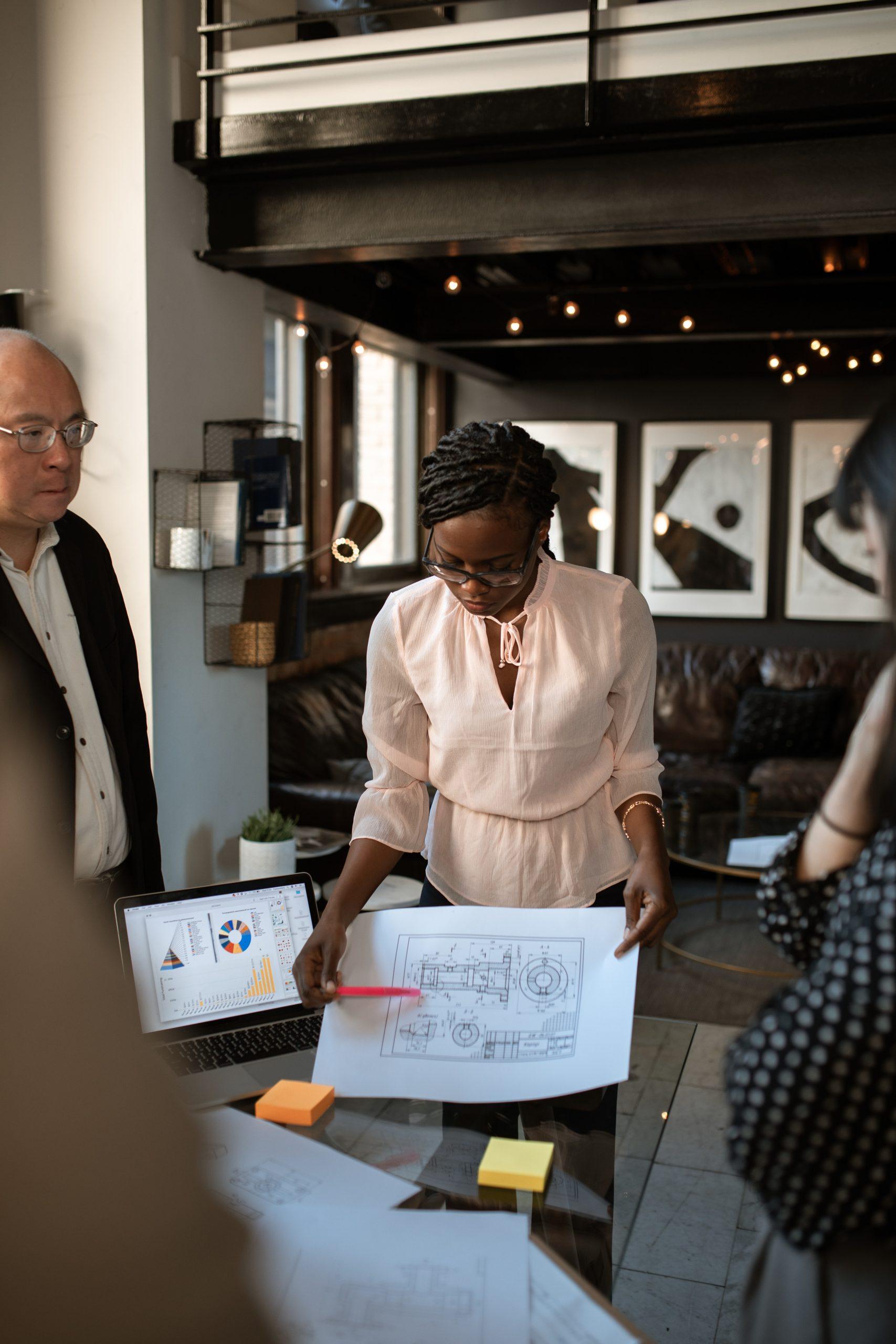 Black woman leading meeting