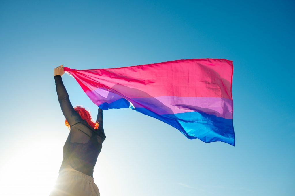 Woman holding bi pride flag