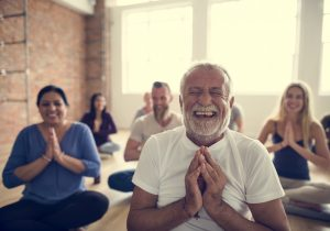 Yoga class full of smiling people