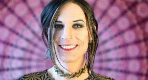 Trans woman smiling at the camera