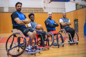 Wheelchair basketball team posing for a photo