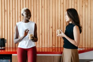 2 colleagues discussing inclusion over coffee