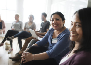 Group of diverse people attending a mental health support group